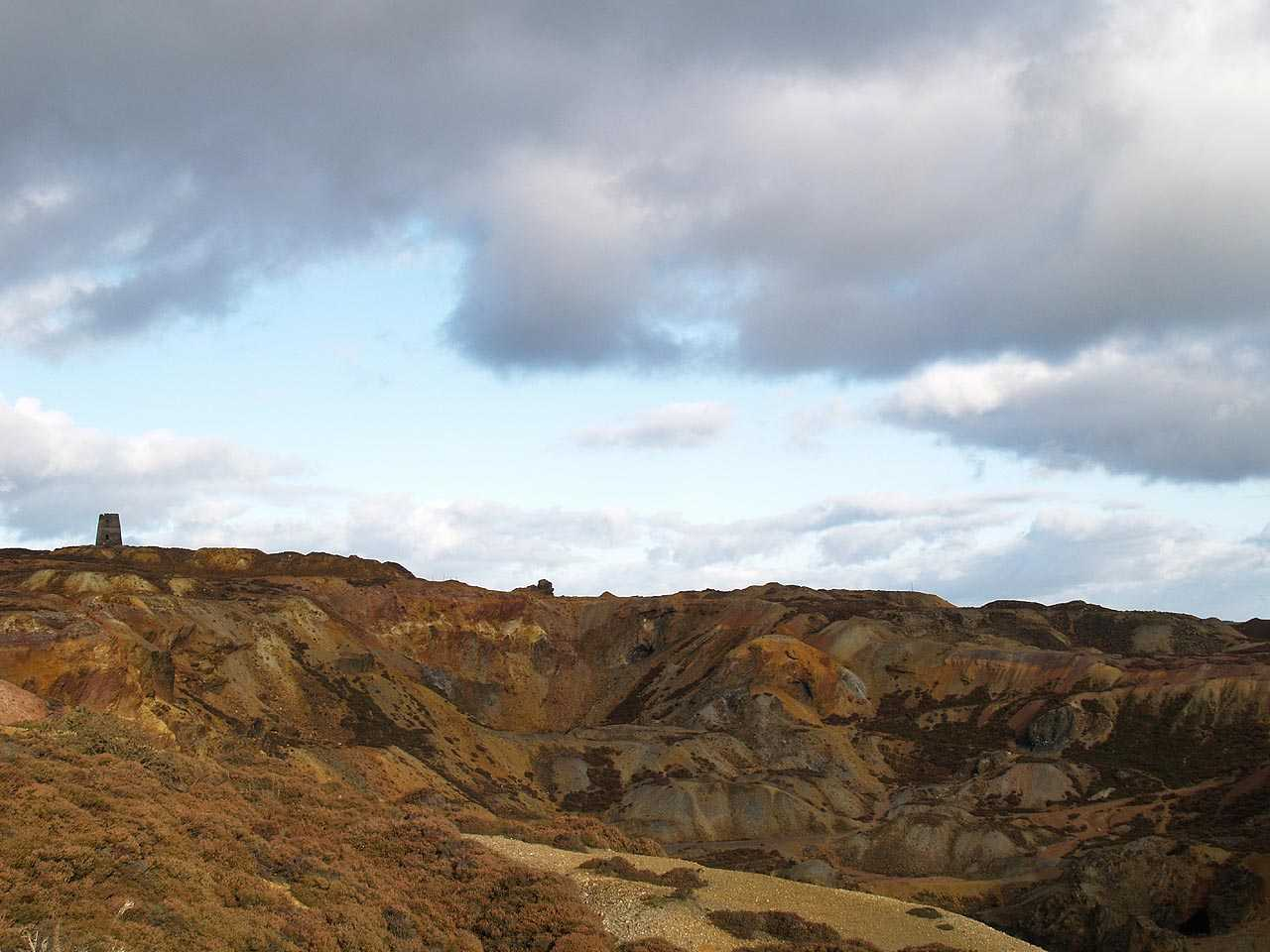 Anglesey, Amlwch, Parys Mountain Windmill surrounded by the multi coloured copper mining waste