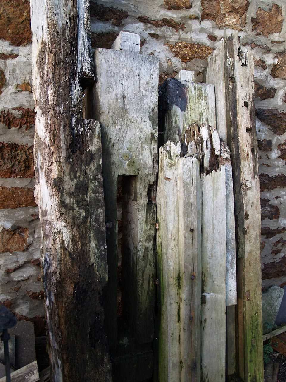 City Dulas, Felin Dulas Watermill - Internal timbers waiting to be burnt
