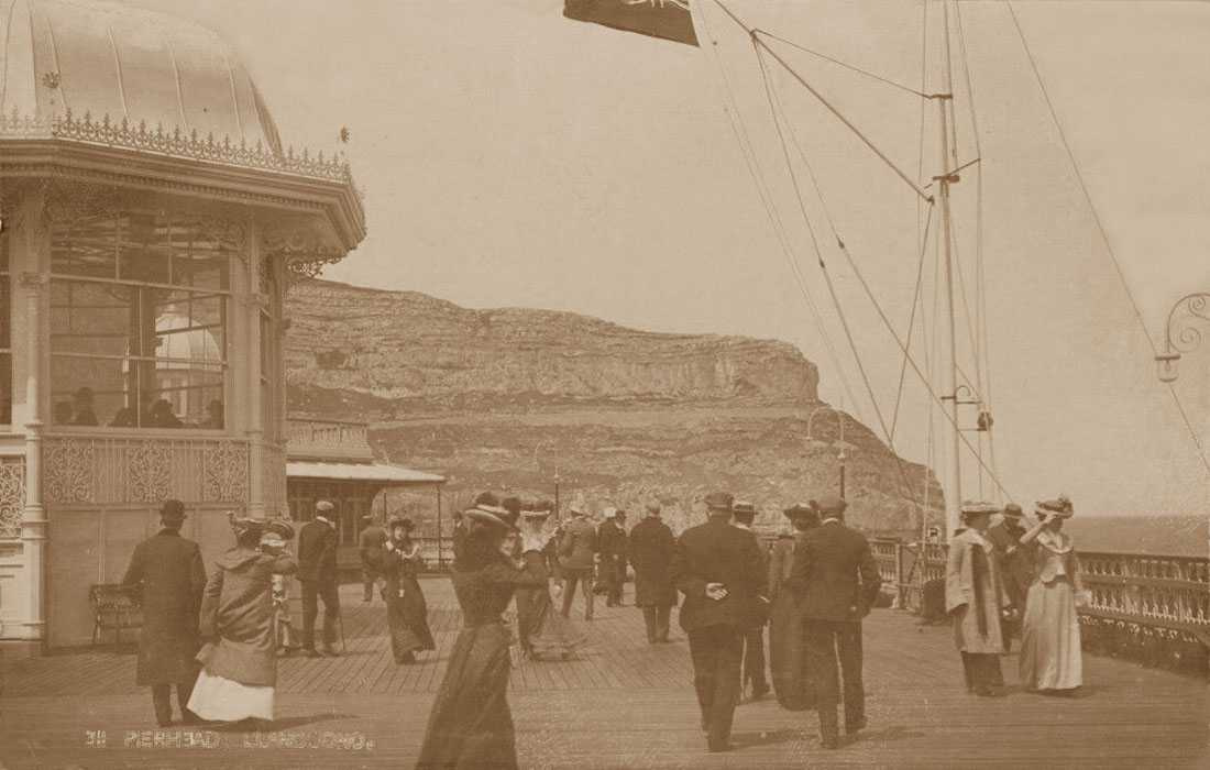 llandudno pierhead with edwardian ladies wearing fashionable hats