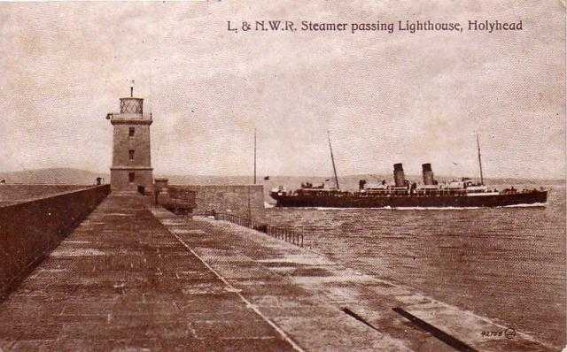 Holyhead, L and NWR Steamer passing the Breakwater Lighthouse